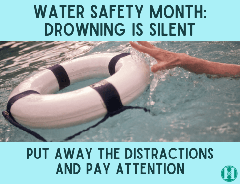 Water Safety Month Hand reaching for life preserver